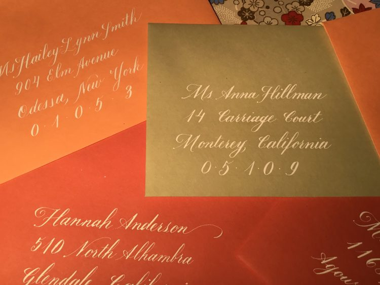 white copperplate envelope addressing