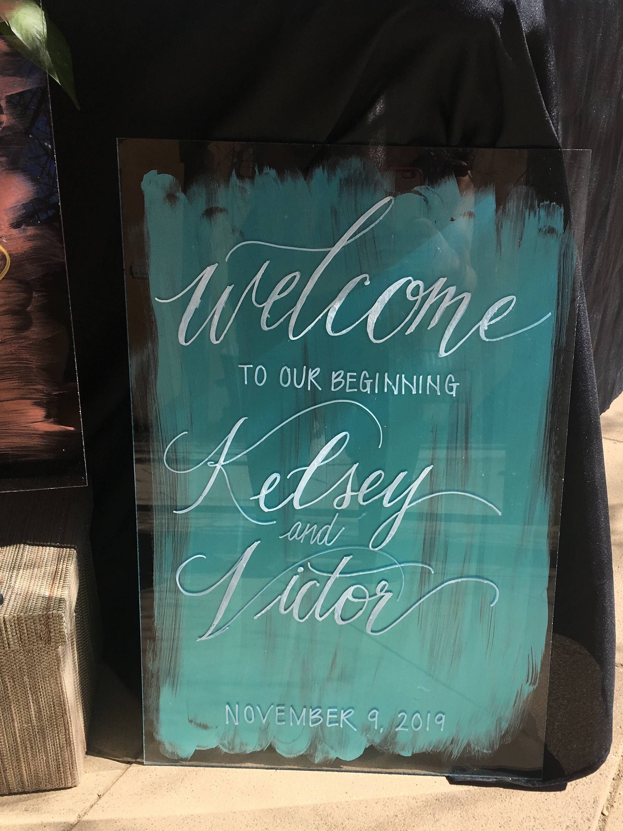 color wash decorated wedding welcome sign with modern calligraphy