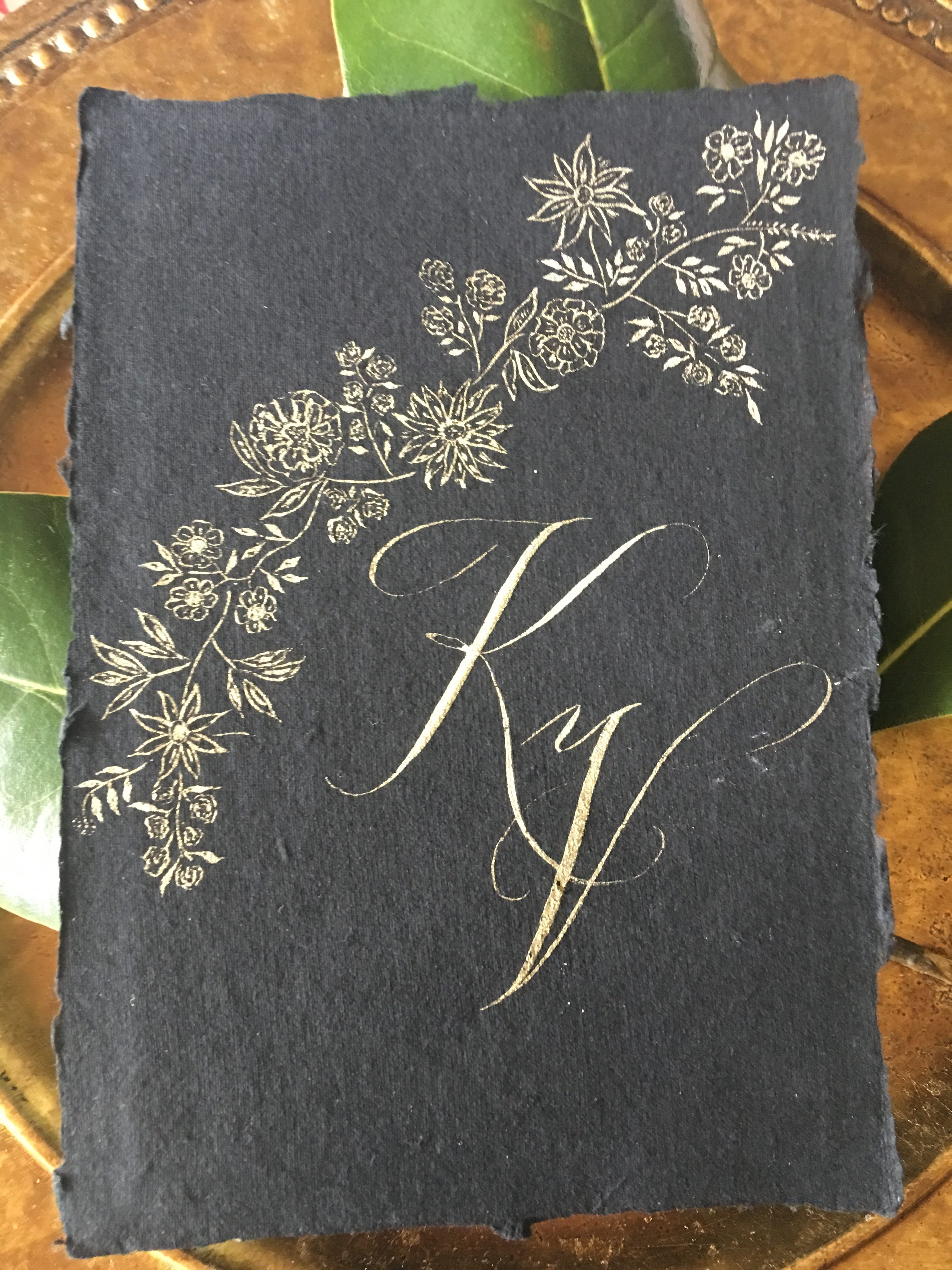handmade paper with floral vine and custom monogram